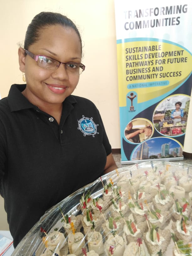 Mrs. Danielle Sargeant showcasing smoked fish sandwiches