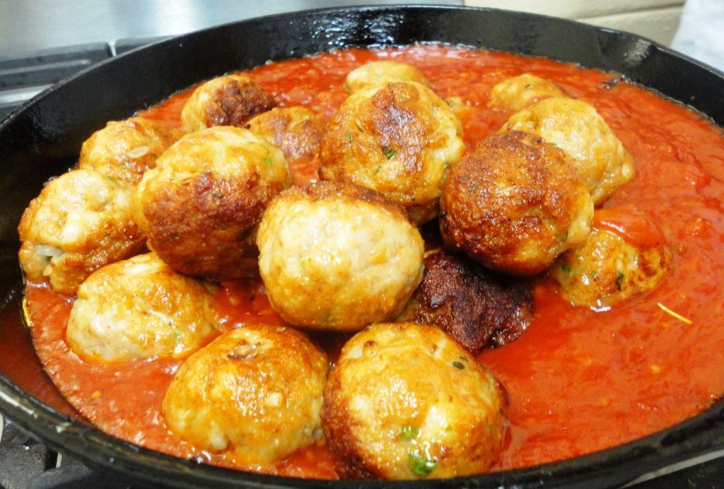 Spicy fish balls in a marinara sauce